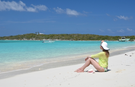 coolie hat: Beach scene, Great Exuma, Bahamas Stock Photo