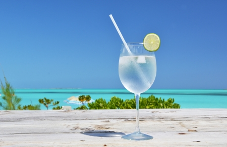 Glass of water on the tropical beach  Stock Photo
