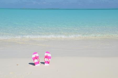 Flip-flop on the beach photo