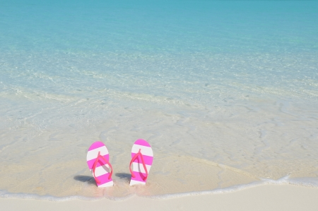 Women s shoes: Flip-flop on the beach