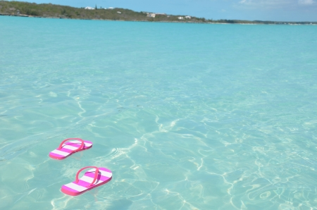 Women s shoes: Flip-flops in the water. Great Exuma, Bahamas