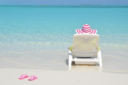 beach hat: Beach scene, Great Exuma, Bahamas Stock Photo