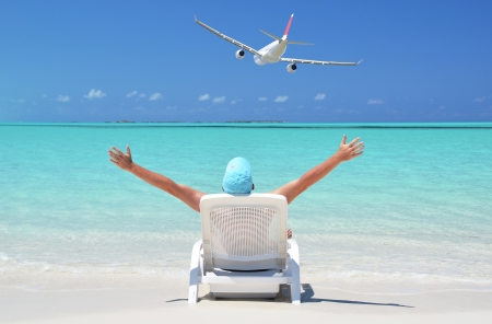 coolie hat: A  man sunbathing on the beach of Great Exuma, Bahamas