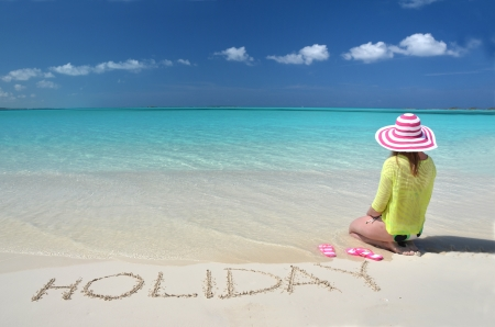 Girl relaxing on the beach of Exuma, Bahamas photo