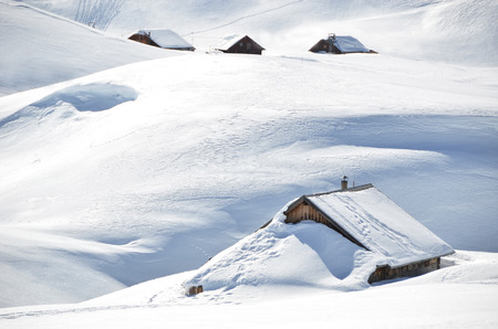 snowbank: Farm house buried under snow, Melchsee-Frutt, Switzerland