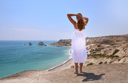 Girl looking to the Aphrodite birthplace, Cyprus photo