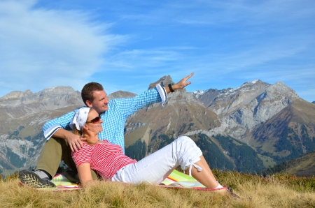 Young couple enjoying Alpine panorama. Switzerland  photo