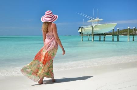 brim: Girl on the beach. Great Exuma, Bahamas Stock Photo