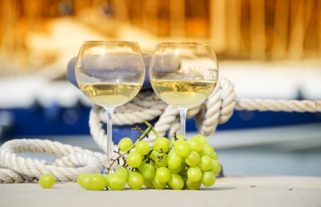 mooring: Wineglasses and grapes on the yacht pier of La Spezia, Italy