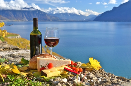 Red wine, chees, bread and cherry tomatos  Lavaux, Switzerland photo