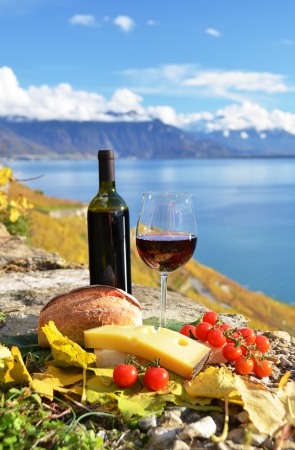 Red wine, chees, bread and cherry tomatos  Lavaux, Switzerland Stock Photo