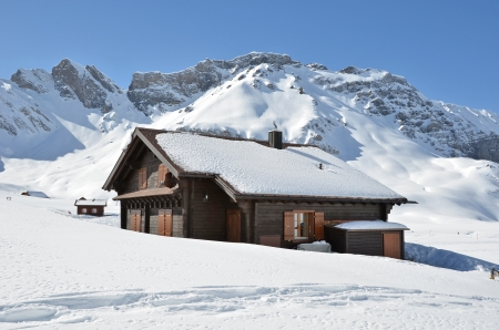 alpine hut: Farm house buried under snow, Melchsee-Frutt, Switzerland