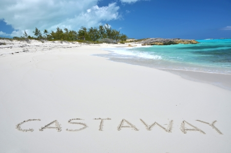 castaway: Castaway writing on a desrt beach of Little Exuma, Bahamas