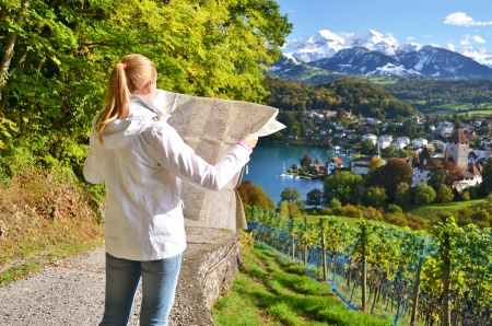 Girl looking to the map. Switzerland photo