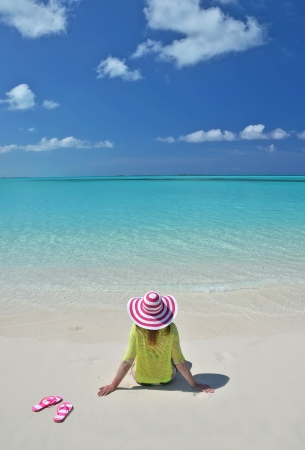 sandy feet: Girl on the beach. Great Exuma, Bahamas Stock Photo