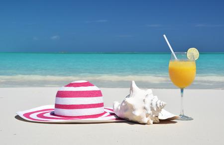 Hat and orange juice. Exuma, Bahamas photo