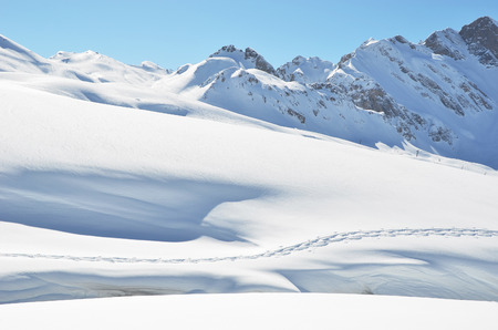 snowbank: Footsteps on the snow. Melchsee-Frutt, Switzerland Stock Photo