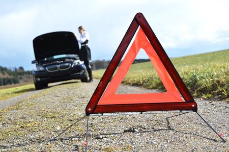 warning triangle: Broken car, girl and warning triangle