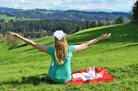 switzerland flag: Jug of milk on the Swiss flag. Emmental, Switzerland