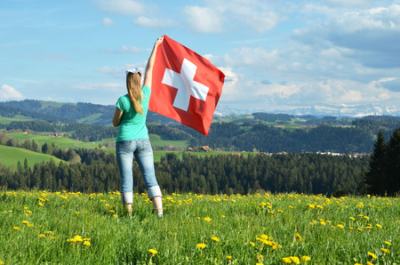 emmental: Girl with the Swiss flag. Emmental, Switzerland Stock Photo
