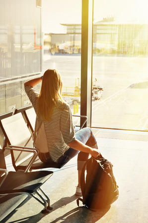 Girl at the airport window  photo