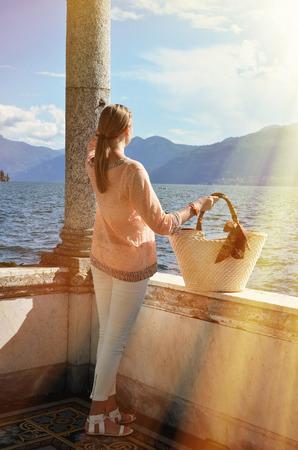lake house: Girl with a basket bag at the Como lakem, Italy