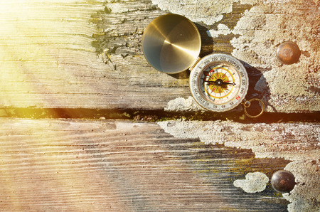 Compass on the wooden background photo