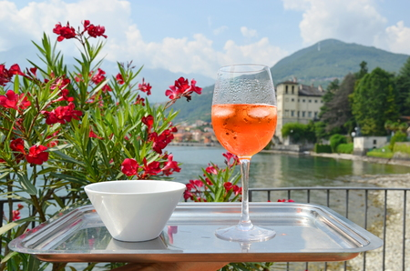Traditional Italian Spritz cocktail against lake Como, Italy Stock Photo