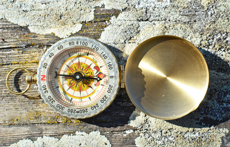 azimuth: Vintage compass on the wood