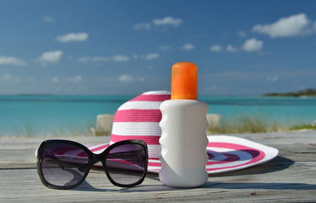 sun lotion: Hat, sunglasses and sun lotion. Exuma, Bahamas