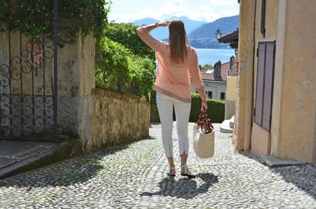 Girl on the cobbled street of Menaggio town. Lake Como, Italy Stock Photo