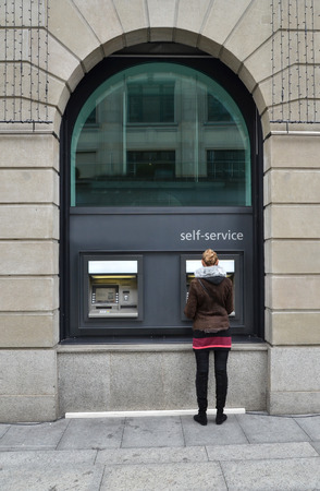 automatic teller machine bank: Girl at ATM Editorial
