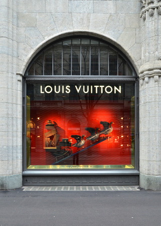 ZURICH, SWITZERLAND - DECEMBER 29, 2013 - Louis Vuitton shop, well known for its luxury trunks, leather goods, shoes, watches, jewelry and accessories