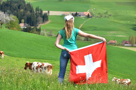 Girl with the Swiss flag. Emmental, Switzerland Stock Photo