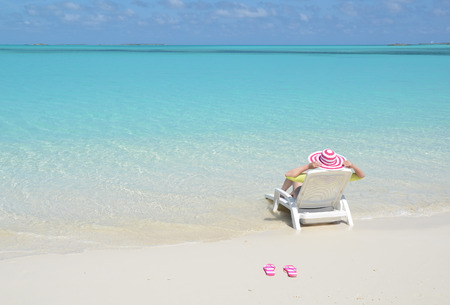 coolie hat: Girl relaxing on the beach of Exuma, Bahamas