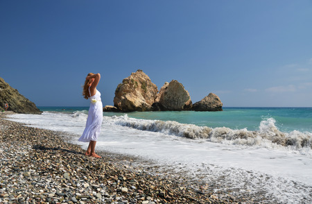 Pebble Beach: Girl on the beach near Aphrodite birthplace, Cyprus