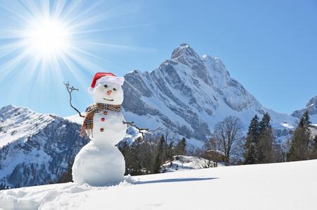 snow scenes: Snowman against Alpine panorama