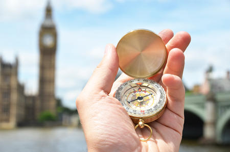 azimuth: Compass in the hand against Big Ben in London