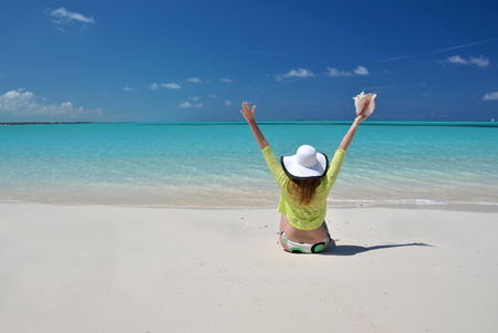 Girl in the hat on the beach of Exuma, Bahamas photo