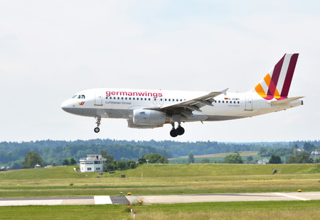 hubs: ZURICH, SWITZERLAND - MAY 25, 2014: El German Wings airlines landing at Zurich international airport on May 25, 2014. Zurich International Airport is one of the major Europian Hubs.