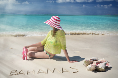 sandy feet: Beach scene, Great Exuma, Bahamas Stock Photo