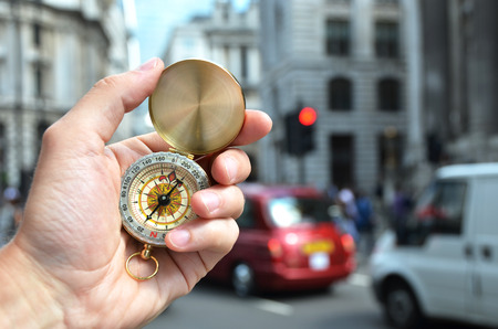 buss: Compass in the hand on a street of London