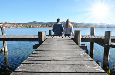 dream lake: A couple on the wooden jetty at a lake