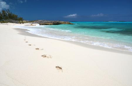 feet in sand: Footprints on the desrt beach of Little Exuma, Bahamas