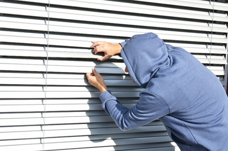 prying: Thief at the window Stock Photo