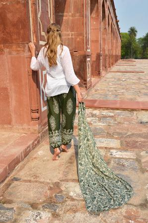 downshifting: Young woman in the traditional Indian punjabi dress at Humayuns Tomb. Delhi, India Stock Photo
