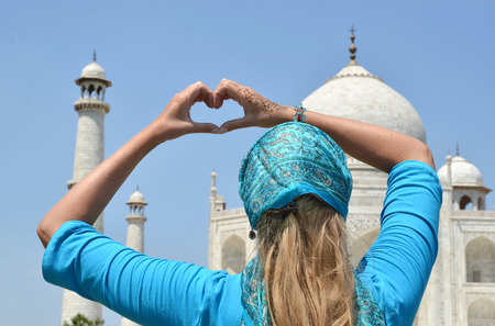 agra: Heart-shaped hands against Taj Mahal. Agra, India