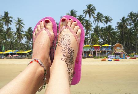 downshifting: Henna tattoo on the foot. Palolem beach of South Goa, India Stock Photo