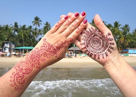 downshifting: Henna tattoo on the hand. Palolem beach of South Goa, India