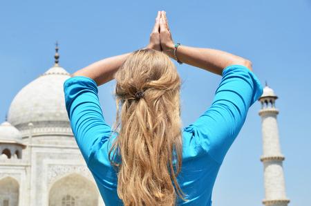 prayer tower: Young woman meditating atTaj Mahal. Agra, India